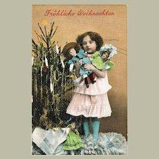 Girl with 3 Dolls. Vintage Xmas Postcard 1910