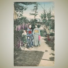 2 Japanese Ladies in Kimono in a Garden. Vintage postcard.