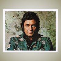 Johnny Cash Autograph: Hand signed Photo 10 x 8. CoA