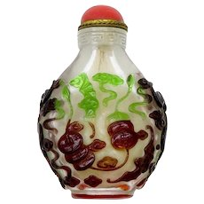 Attractive old Chinese Overlay Snuff Bottle with Coral Stopper.