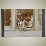 Group of People with Doll in front of Coffee Shop