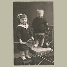 Cute Photo of Girl with Tennis Racket 1915