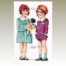 Embossed Die Cut with 2 Girls and Doll. Decorative, 1920s