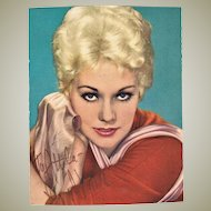 Kim Novak Autograph on Early Portrait Postcard. CoA
