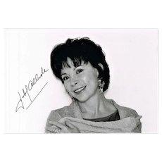 Author Isabel Allende autograph on b/w portrait photo. CoA