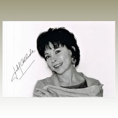 Author Isabel Allende autograph on b/w portrait photo. CoA