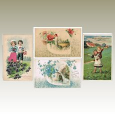 Four old embossed Name Day Postcards