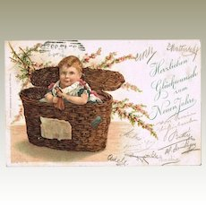 Funny new Years Postcard Girl in a Basket 1899