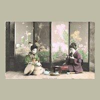 Japanese Ladies in Kimono taking Dinner. Old Tinted Postcard