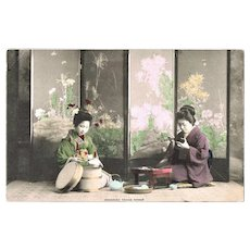 Japanese Ladies in Kimono taking Dinner. Old Tinted Postcard