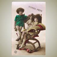 Cute French New Years Postcard of Kids with Doll. 1925