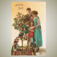Xmas Postcard of Family with Dolls and Christmas Tree