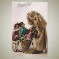 Very attractive Xmas Postcard from app. 1910 Santa brings Dolls