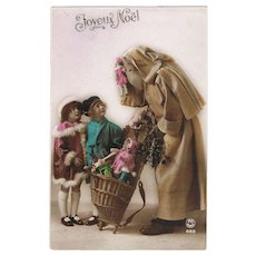 Very attractive Xmas Postcard from app. 1910 Santa brings Dolls