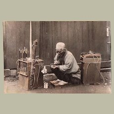 Japanese Peddlar selling Pipes. Albumen Photo from app. 1880s.