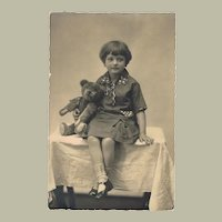 Old Photo of Girl with Teddy Bear