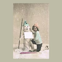 Tinted Postcard with Snowman and Girl from 1907