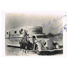 Gene Autry Autograph on Photo as Cowboy and Truck. CoA