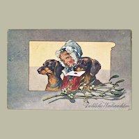 Two Dachshund on vintage Christmas Postcard 1906