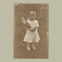 Girl with her Doll Vintage Postcard
