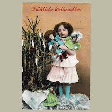 Girl with 3 Dolls Vintage Xmas Postcard from 1910