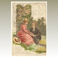 Romantic Lithographed Postcard: A Couple and Cupid. 1919
