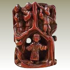 Netsuke: Wooden Toggle with Journey to the West Scene.