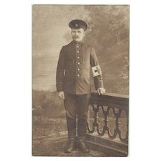 WW1: Soldier with Red Cross Brassard. Vintage Photo.