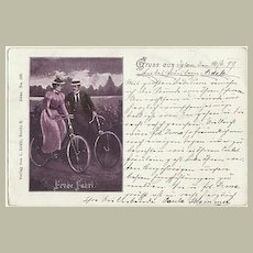 Happy Biking! Vintage postcard with Couple on Bikes from 1899.