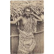 Singapore, c. 1910. Portrait postcard of a young Malay woman.