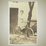 Lady riding a Bicycle Vintage Photo