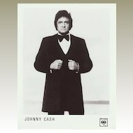 Johnny Cash: Old Press Lot with 3 large Photos and Biography.