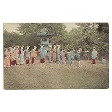 Japanese Girls playing. Tinted postcard sent China to Austria. 1916