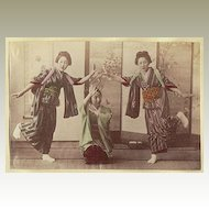 Girls performing. Japanese, tinted Albumen Photo. 1880s