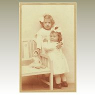 2 little Girls with their Doll: Studio photo from Austria, 1918