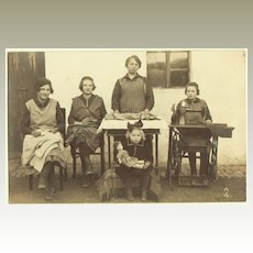 Little Girl with Doll and Ladies at Work. Old Photo