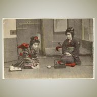 Japanese Geishas at Tea Ceremony. Tinted Postcard