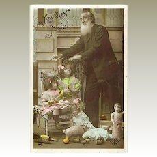 Xmas Postcard, Girls with Doll 1907
