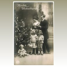 Vintage Xmas Postcard, Family with Kids and Doll