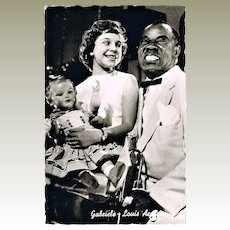 Louis Satchmo Armstrong and Gabriele, holding a big doll.