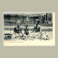 """""""Greetings from Singapore"""". Men, offering  daggers. Vintage Postcard."""