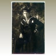 1913: Photo of US Navy member as Postcard to Austria