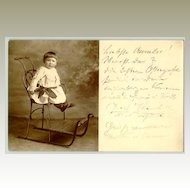 1909: Little Girl in a Toboggan. Old Austrian Postcard