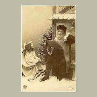 1917: Postcard of Santa with an Angel
