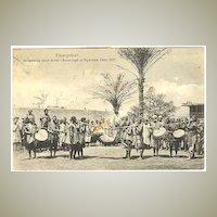 1911: Lion Hunting: African Hunters celebrating after the Hunt. Vintage Postcard.