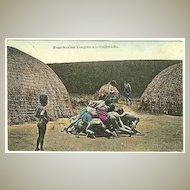 Black Kids fighting for Nickels – tinted Vintage postcard. Postal History.