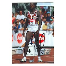 Carl Lewis Autograph on German Photo from 1994