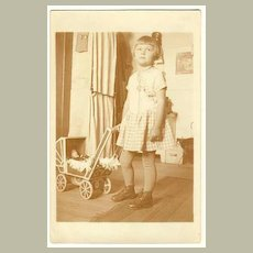Girl with Doll in Pram: Vintage Photo, ca. 1920