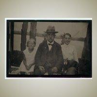 Older Gentleman with 2 Children an a Dog Photograph