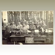 Group of workers at their work bench c. 1910